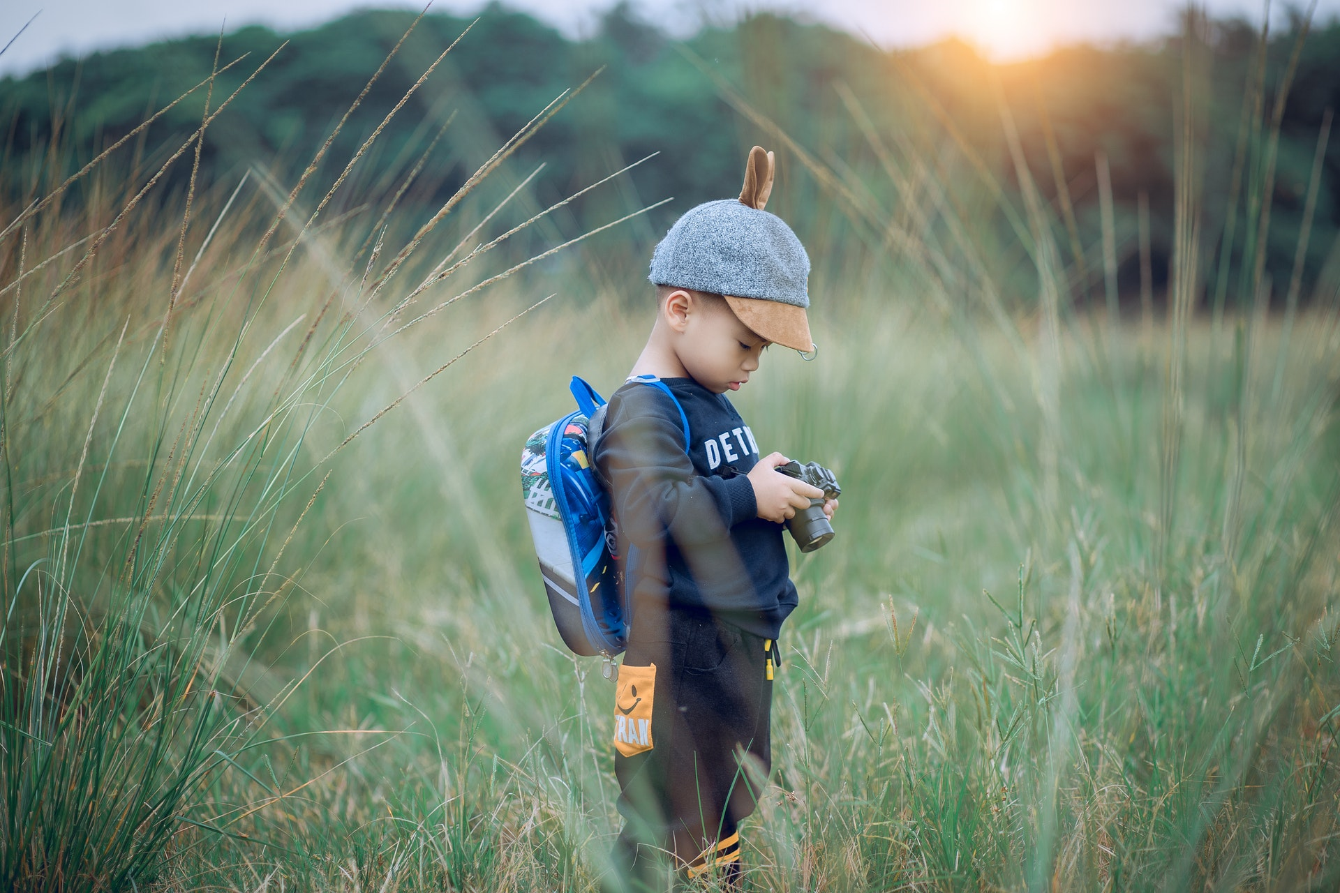 toddler-holding-camera-1549974